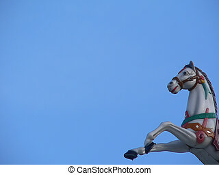 Carrousel horse bust on blue sky
