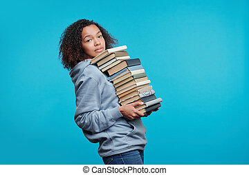Carrying big stack of books