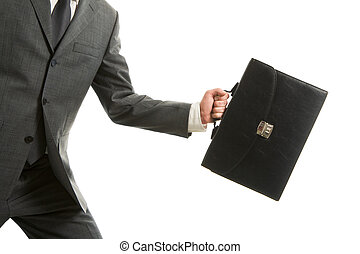 Carrying briefcase - Close-up of businessman with briefcase...