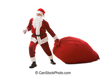 Carrying heavy sack - Portrait of happy Santa carrying heavy...