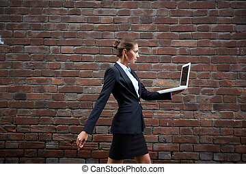 Carrying laptop - Image of confident businesswoman with...
