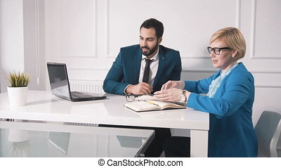 Carrying the Task with Laptop - Serious businesswoman in...