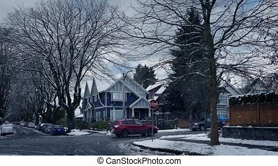 Cars And Truck Pass Through Snowy Suburbs