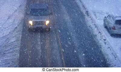 Cars And Trucks Passing In Blizzard