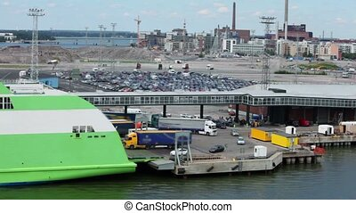Cars ant trucks ride to ferry boat in dock with huge parking