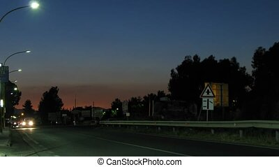 Cars are carried by on night highway.