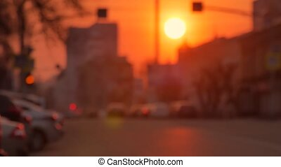 Cars are in traffic jam during a beautiful golden sunset