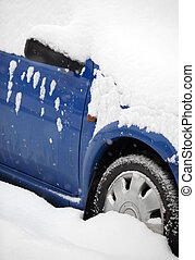 cars covered with snow after a heavy snowfall in a city