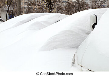 Cars Covered with Snow - Snowy cars trapped in snowdrift,...