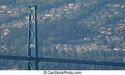 Cars Crossing Bridge To Suburbs - Suspension bridge with...