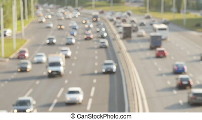 Cars drive along the highway. Defocus shot above