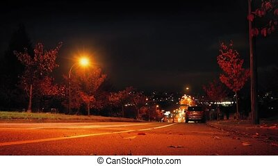 Cars Drive Down Hill In City Night