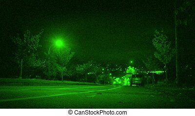 Cars Drive Down Hill In City Night Vision