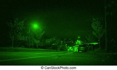 Cars Drive Past Houses In City Night Vision