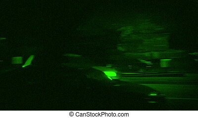 Cars Drive Past Houses In City Night Vision - Couple of cars...