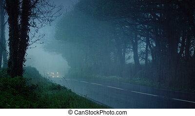 Cars Drive Through Countryside In The Rain