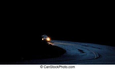 Cars Drive Through Dark Rainy Woods - Couple of cars emerge...