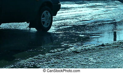 cars drive through the puddles movement of traffic and snow...