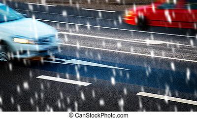Cars driving along the crossroads on snowfall