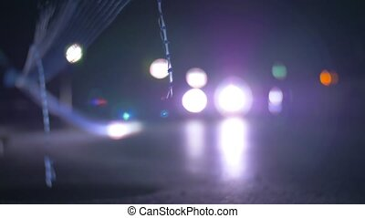 Cars driving at night and flashing with headlights - Slow...