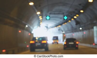 Cars driving in the tunnel bokeh background. 4k, 3840x2160...