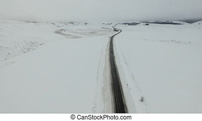 Cars driving on a winter road.