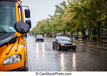 Cars driving on the rainy road