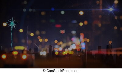 Cars driving towards fireworks on city road in the evening