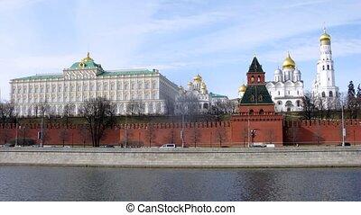 Cars go in front of Kremlin on Kremlevskaya Embankment, time...
