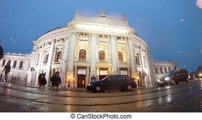 Cars go near to Burgtheater in rain