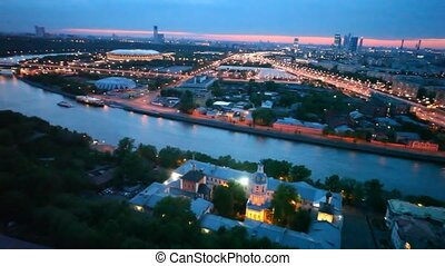 Cars go on Andreesvky bridge in central district of Moscow...