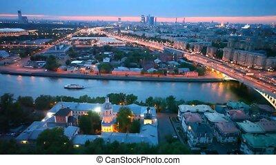 Cars go on Andreesvky bridge through river where steam-ship...