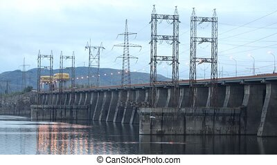 Cars go on bridge which is also spillway dike closeup, time...