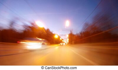 Cars go on high-speed highway in evening, time lapse