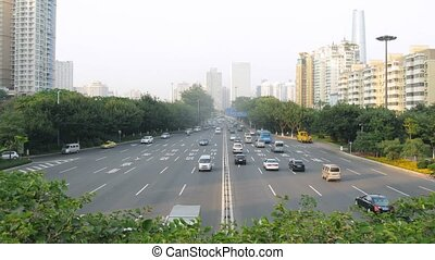 Cars go on high-speed road towards Guangzhou Bridge to river