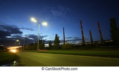 Cars go on highway in front of chimney shaft of manufacturing plant AUTOVAZ