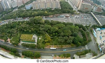 Cars go on highway near to skyscrapers, panorama