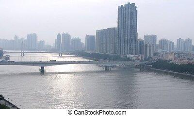 Cars go on Jiangwan bridge and Haiyin Bridge in afternoon
