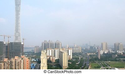 Cars go on road near to Construction Guangzhou New TV Broadcasting Office Building
