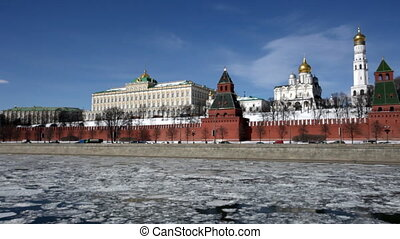 Cars go on the Kremlin embankment in Moscow in sunny spring day, panoramic shooting