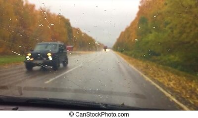 cars go on the road asphalt. autumn beautiful view forest,...