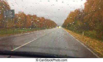 cars go on the road asphalt. autumn travel beautiful view...