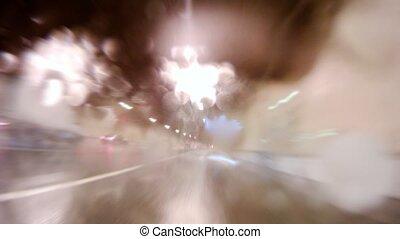 Cars go on wide range highway during rain