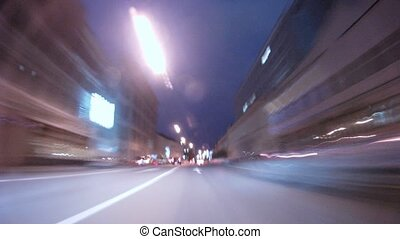 Cars go on wide range highway in downtown