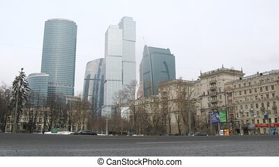 Cars goes on prospectus before center Moscow City and Stalin house stand on right