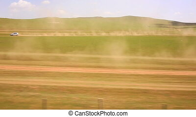 cars going vast grassland of mongolia, view from trans ...