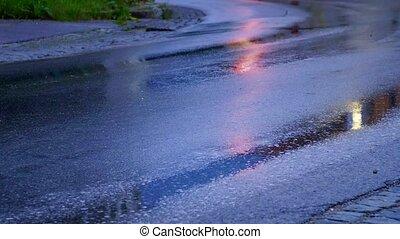 cars head light on rainy day