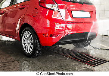 Cars in a carwash - Red cars in a professional carwash...