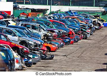 Old cars are appelt confess to a scrap yard. Scrap cars in a junkyard.