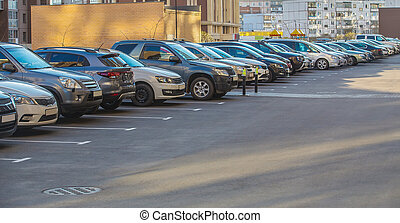 Cars in a parking lot in a residential area